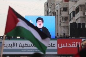 Hassan Nasrallah, the head of Hezbollah, addresses crowds remotely at a rally in Beirut on Dec. 11, 2017. (AFP/Getty Images)