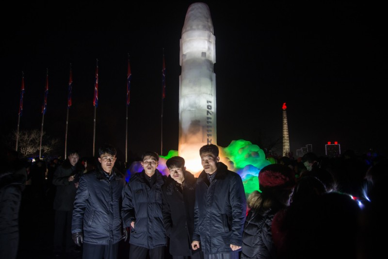 A group of men stand before an ice sculpture of a Hwasong-15 intercontinental ballistic missile at an ice sculpture festival in Pyongyang, North Korea, on Dec. 31, 2017. (Kim Won-Jin/AFP/Getty Images)