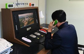 A South Korean government official checks the direct communications hotline to talk with the North Korean side at the border village of Panmunjom on Jan. 3, in Panmunjom, South Korea. (South Korean Unification Ministry via Getty Images)