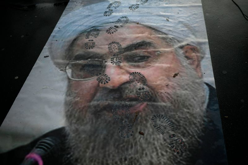 A portrait of Iranian President Hassan Rouhani with shoe marks over it during a demonstration in support of the Iranian people amid a wave of protests spreading throughout Iran in Paris on Jan. 3, 2018.