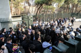 Iranian students scuffle with police at the University of Tehran on Dec. 30, 2017. (STR/AFP/Getty Images)