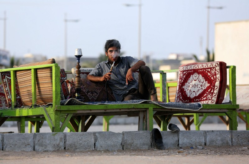 An Iranian man smokes a water pipe in the southern Iranian city of Chabahar on May 12, 2015. (ATTA KENARE/AFP/Getty Images)