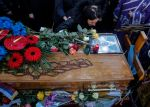 A relative mourns on the coffin of late Kosovo Serb politician Oliver Ivanovic, during his funeral ceremony at the cemetery Novo Groblje in Belgrade on Jan. 18. (Oliver Bunic/AFP/Getty Images)