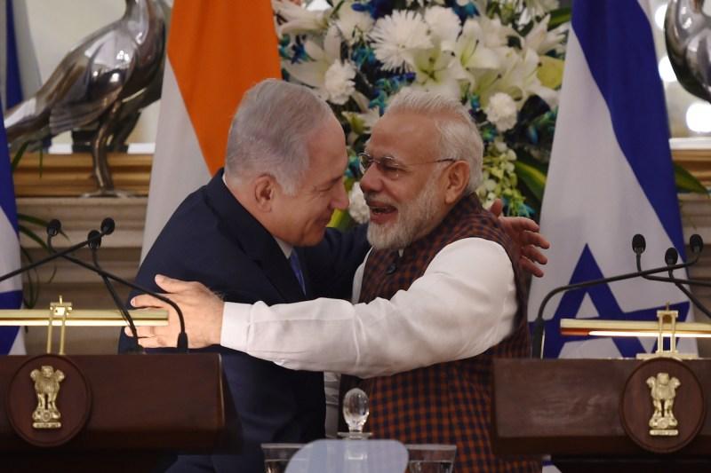 Indian Prime Minister Narendra Modi hugs Israeli Prime Minister Benjamin Netanyahu during a press conference at Hyderabad House in New Delhi on January 15, 2018.