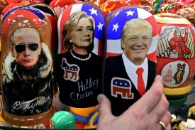 Traditional Russian wooden nesting dolls, Matryoshka dolls, depicting Russia's President Vladimir Putin, U.S. Democratic presidential nominee Hillary Clinton and US Republican presidential nominee Donald Trump are seen on sale at a gift shop in central Moscow on Nov. 8, 2016. (Kirill Kudryavtsev/AFP/Getty Images)