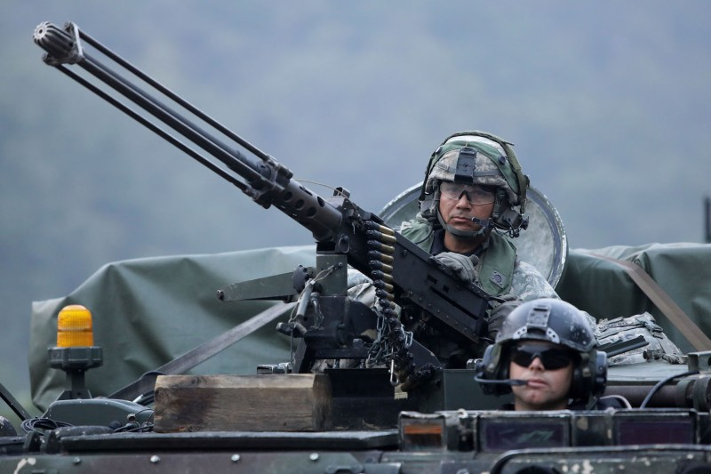 U.S. soldiers on M113 armored vehicles take part during the Warrior Strike VIII exercise at the Rodriguez Range on Sept. 19, 2017, in Pocheon, South Korea. (Chung Sung-Jun/Getty Images)
