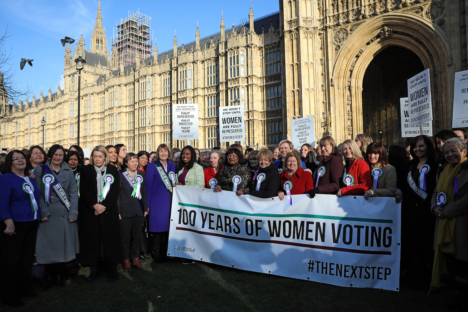 Female members of the Shadow Cabinet and Labour politicians stand on college green with a '100 Years of Women Voting' banner in London, England on Feb. 6. (Photo by Dan Kitwood/Getty Images)