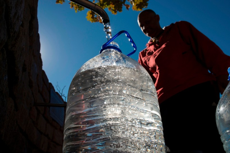 A man collects drinking water from taps in Cape Town, South Africa, on May 15, 2017. (Rodger Bosch/AFP/Getty Images)