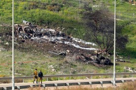 A picture taken in the northern Israeli Kibbutz of Harduf on Feb. 10, shows the remains of an Israel F-16 that crashed after coming under fire by Syrian air defenses.