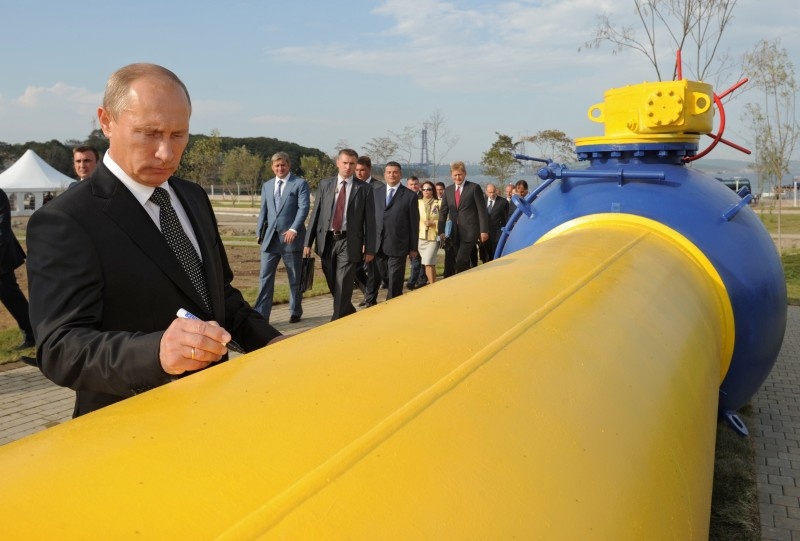 Vladimir Putin signs a natural gas pipeline in the Russian Far East city of Vladivostok on September 8, 2011. (DMITRY ASTAKHOV/AFP/Getty Images)