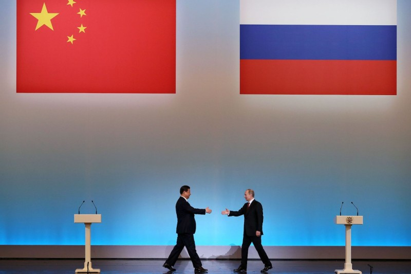 Chinese President Xi Jinping, left, and Russian President Vladimir Putin in Moscow, on March 22, 2013. (Sergei Ilnitsky/AFP/Getty Images)