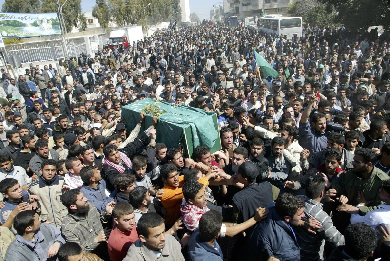 GAZA CITY, GAZA STRIP - MARCH 22: Thousands of Palestinians carry the coffin of Hamas Founder Sheikh Ahmed Yassin during his funeral on March 22, 2004 in Gaza City, Gaza Strip. Yassin was targeted and killed in an Israeli helicopter attack March 22, 2004 after leaving a mosque in the Gaza Strip. (Photo by Getty Images)