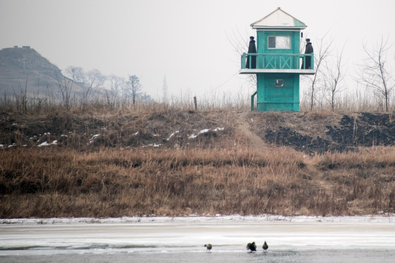 North Korean soldiers stand at their watchtower in February, 2016 on the banks of the Yalu River in the North Korean town of Sinuiju. (Johannes Eisele/AFP/Getty Images)
