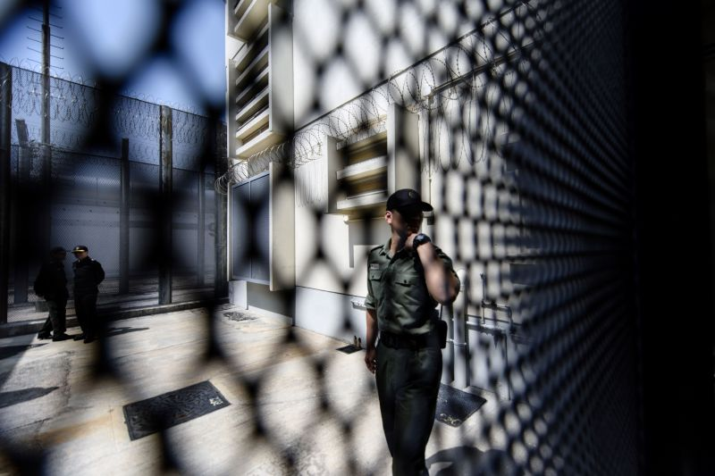 An officer speaks into a radio transmitter at a prison in China. (Anthony Wallace/AFP/Getty Images)
