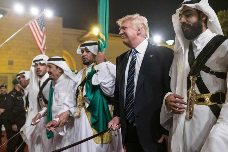 U.S. President Donald Trump brandishes a sword during a welcome ceremony in Riyadh, Saudi Arabia on May 20, 2017. (Mandel Ngan/AFP/Getty Images)