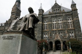 A statue of John Carroll, founder of Georgetown University, sits before Healy Hall on the school's campus August 15, 2006 in Washington, DC. Georgetown University was founded in 1789 and it is the oldest Catholic and Jesuit university in the U.S.  (Photo by Alex Wong/Getty Images)