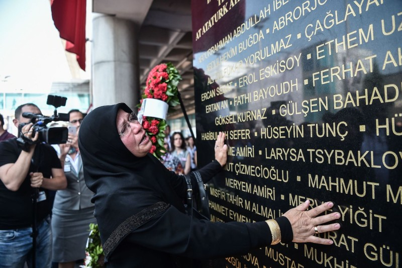 A woman reads names on a commemorative plaque during a memorial ceremony for victims of an Islamic State attack at Istanbul's Ataturk airport, on June 28, 2016. (Ozan Kose/AFP/Getty Images)