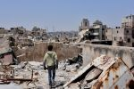 A Syrian boy walks amid the rubble of destroyed buildings in Aleppo, Syria on July 22, 2017. (George Ourfalian/AFP/Getty Images)