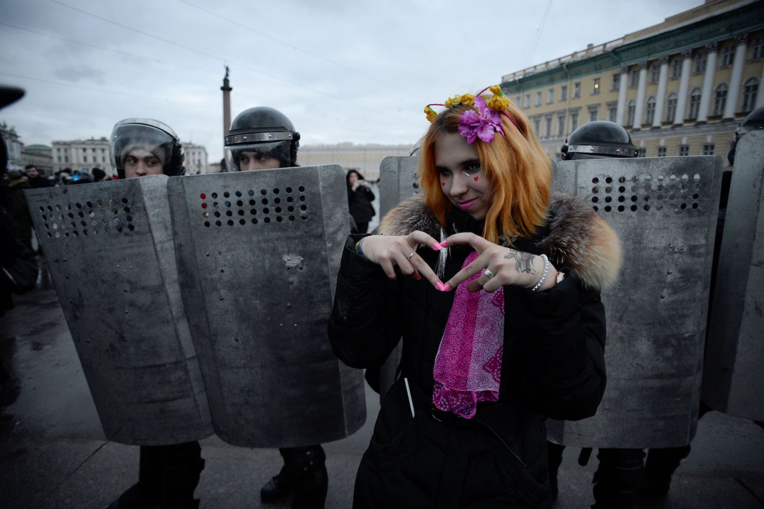 TOPSHOT - A woman gestures in front of riot police during a rally calling for a boycott of March 18 presidential elections, Saint Petersburg, January 28, 2018. / AFP PHOTO / OLGA MALTSEVA        (Photo credit should read OLGA MALTSEVA/AFP/Getty Images)