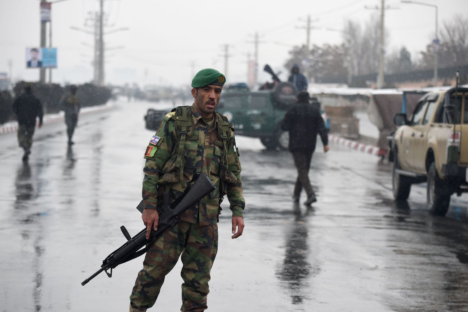 TOPSHOT - Afghan security personnel stand guard near the site of an attack near the Marshal Fahim Military Academy base in Kabul on January 29, 2018. Gunmen launched a pre-dawn attack on a military academy in Kabul on January 29, security officials and sources told AFP, in an ongoing assault that marks the latest violence to strike the Afghan capital.  / AFP PHOTO / WAKIL KOHSAR        (Photo credit should read WAKIL KOHSAR/AFP/Getty Images)