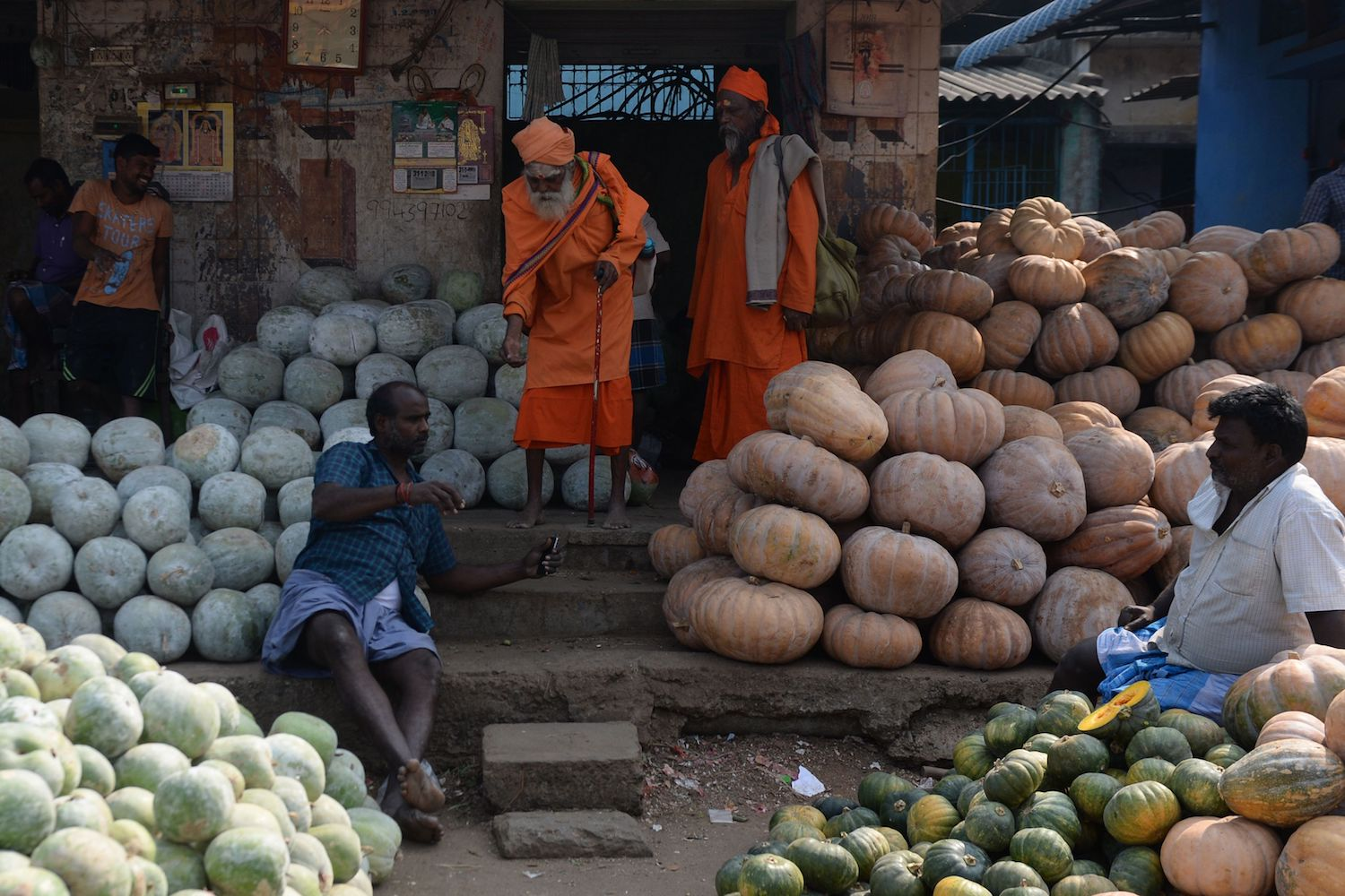 TOPSHOT - Indian pumpkin vendors wait for customers at a wholesale market in Chennai on January 31, 2018. The Indian government is set to focus on the agricultural sector in its annual budget that is released on February 1. / AFP PHOTO / ARUN SANKAR        (Photo credit should read ARUN SANKAR/AFP/Getty Images)