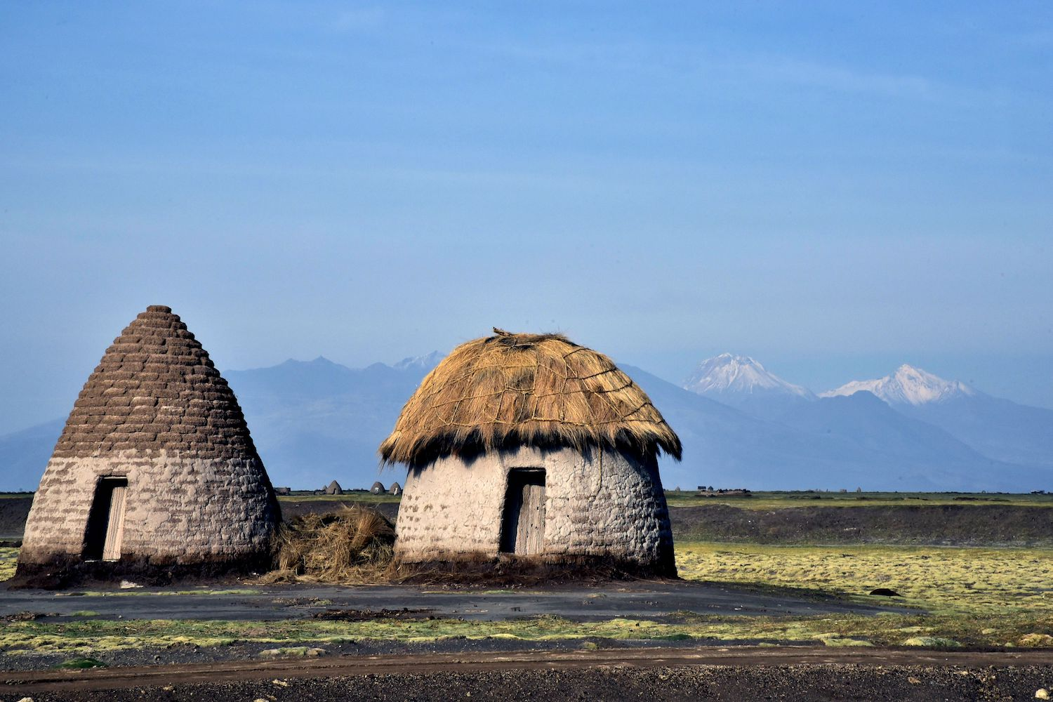 Traditional huts of the Chipaya indigenous community are seen on January 31, 2018, when the new authorities of the autonomous government of the Uru Chipaya indigenous people are sworn in, in the town of Uru Chipaya in southern Bolivia. The authorities of the new autonomous government were elected through different procedures allowed by the national constitution and based on the habits and customs of the Uru Chipaya people, who number just 2,000 today but have lived in the Bolivian highlands for many centuries. / AFP PHOTO / AIZAR RALDES        (Photo credit should read AIZAR RALDES/AFP/Getty Images)