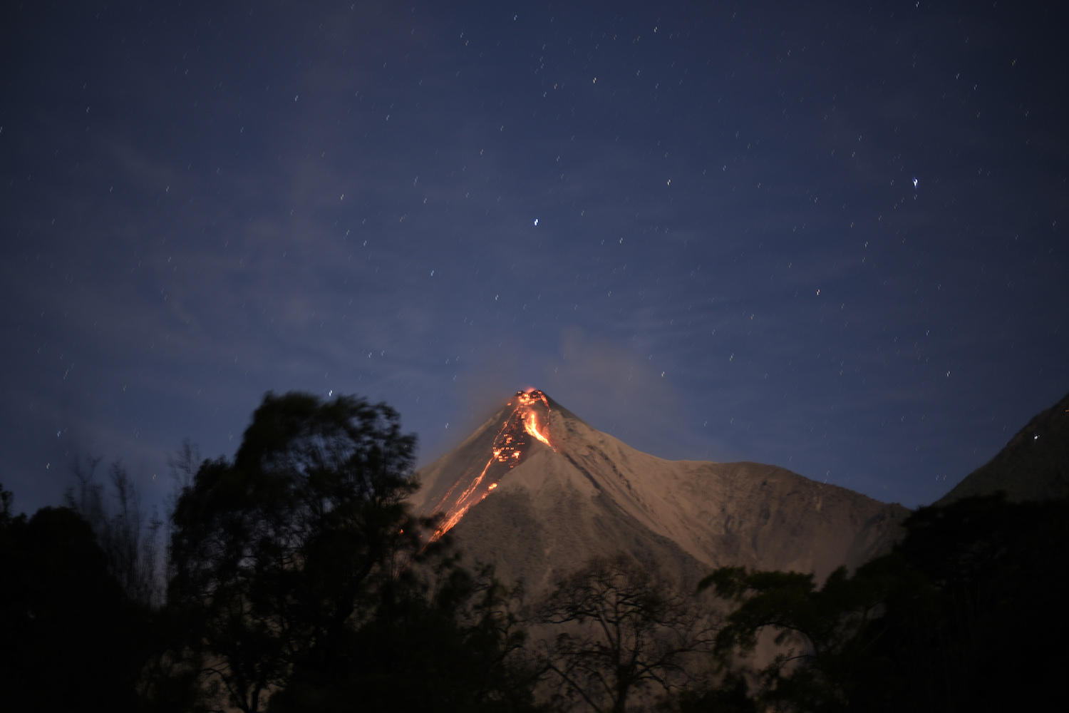 TOPSHOT - The Fuego volcano spews ash, as seen from the city of Alotenango in Sacatepequez departament, 65 km southeast of Guatemala City, on February 1, 2018.  The Fuego volcano, located 35 kilometres southeast of the Guatemalan capital, increased its eruptive activity, spewing ash that reached several villages, civil protection reported. / AFP PHOTO / JOHAN ORDONEZ        (Photo credit should read JOHAN ORDONEZ/AFP/Getty Images)