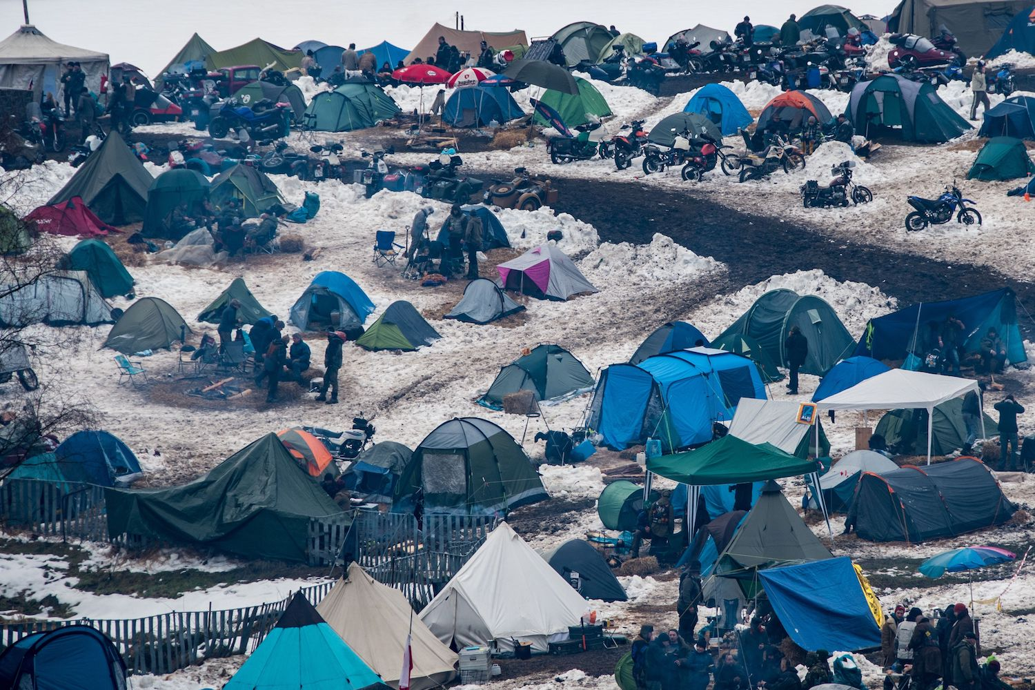 """TOPSHOT - Tents are pitched in the camp of the motorcyclist's gathering """"Elephant""""  in Thurmansbang, southern Germany on February 02, 2018.   / AFP PHOTO / dpa / Armin Weigel / Germany OUT        (Photo credit should read ARMIN WEIGEL/AFP/Getty Images)"""