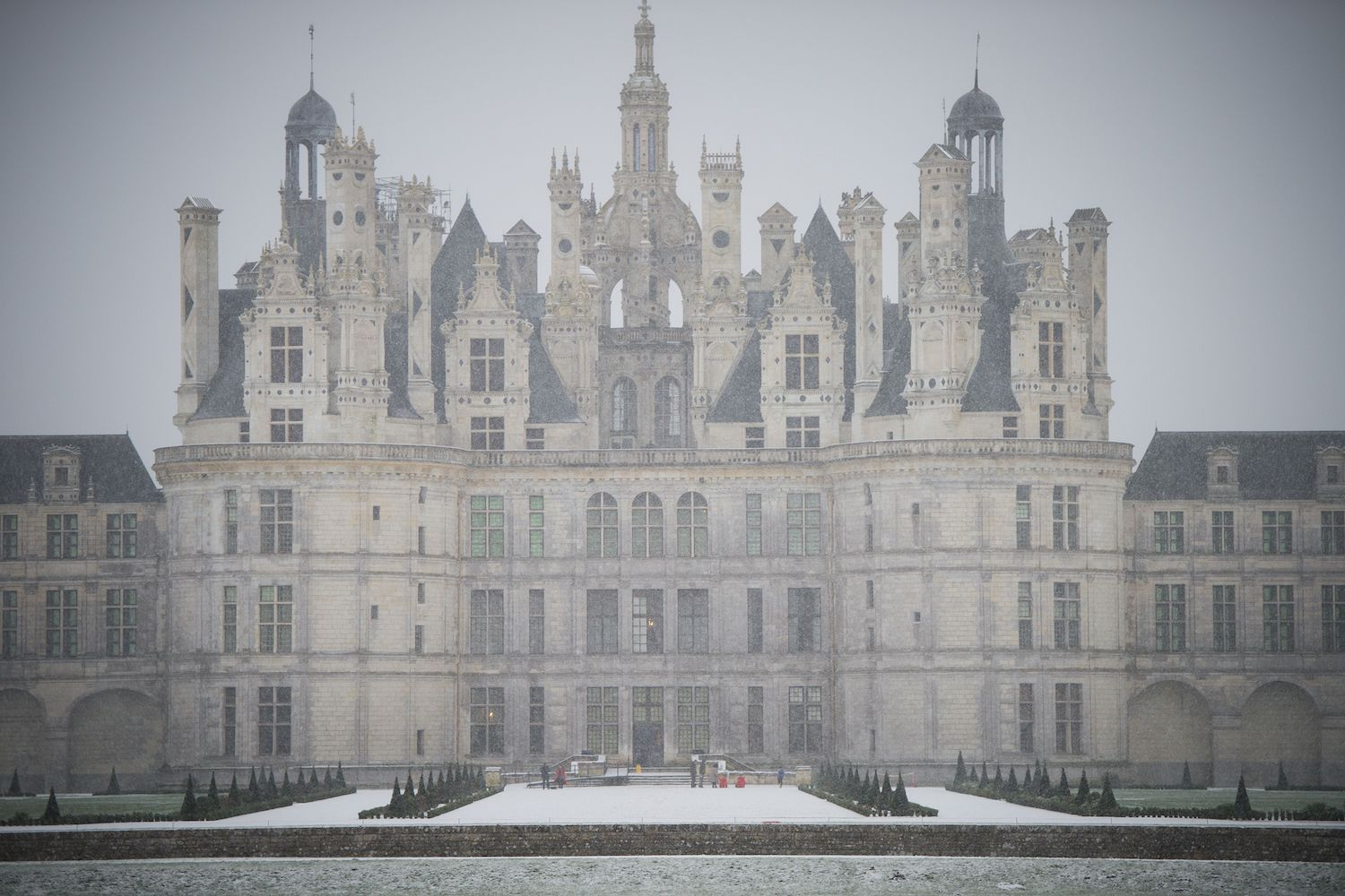TOPSHOT - The French Renaissance Chateau de Chambord is pictured as snow falls on February 13, 2018 in Chambord, northwestern France.  / AFP PHOTO / GUILLAUME SOUVANT        (Photo credit should read GUILLAUME SOUVANT/AFP/Getty Images)