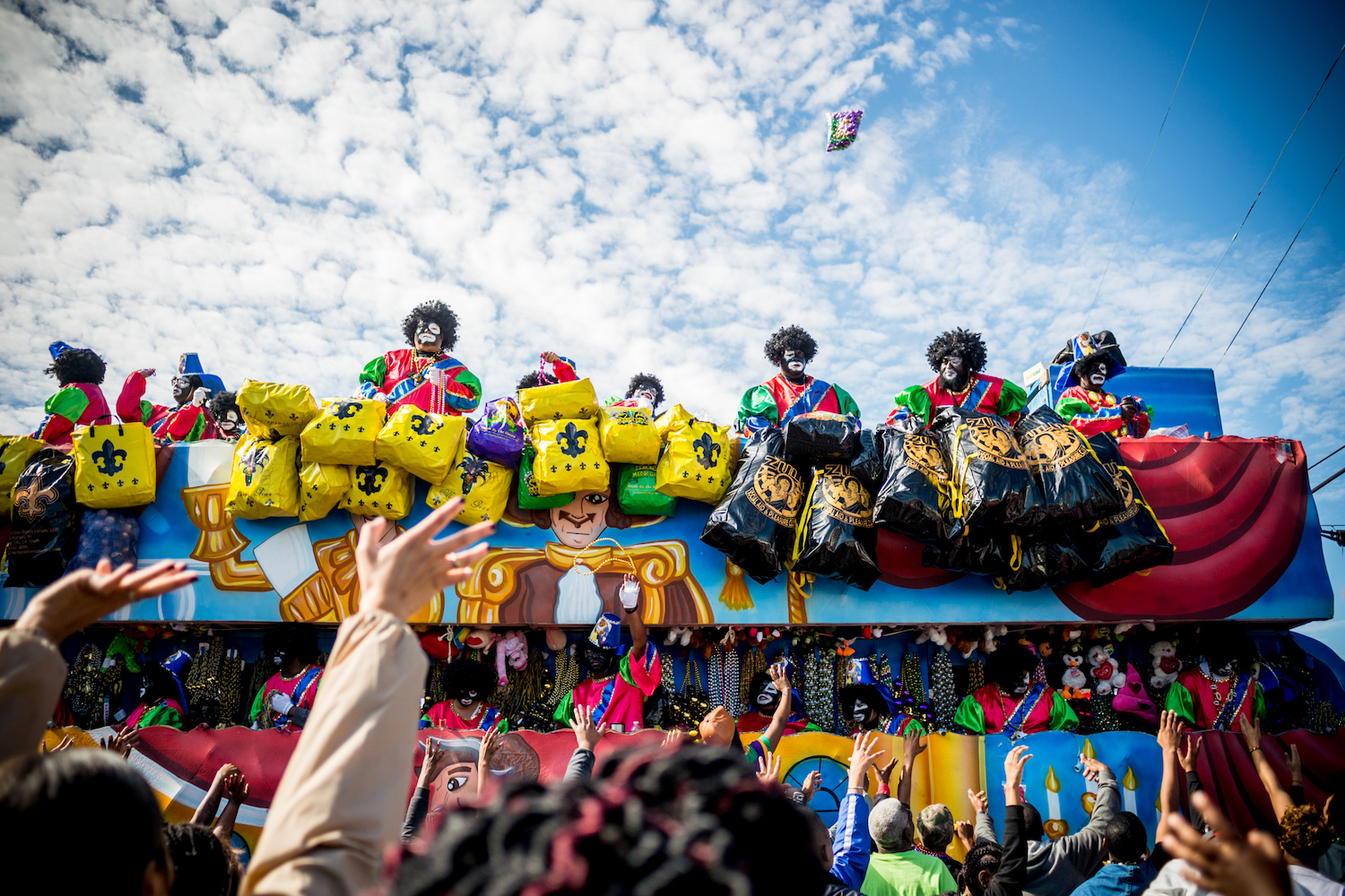 TOPSHOT - People reach out for beads as the Zulu Parade runs through New Orleans on Mardi Gras, February 13, 2018. / AFP PHOTO / 00059360A / Emily Kask        (Photo credit should read EMILY KASK/AFP/Getty Images)