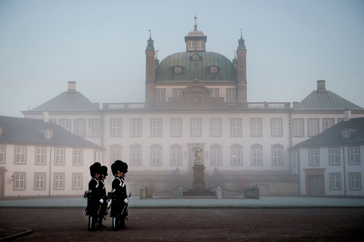 TOPSHOT - Members of the Danish Royal Guard stand in front of Fredensborg Palace in Fredensborg, Denmark, on February 14, 2018, after His Royal Highness Prince Henrik died on Tuesday, February 13, 23:18 at Fredensborg Castle. / AFP PHOTO / Scanpix / Liselotte Sabroe / Denmark OUT        (Photo credit should read LISELOTTE SABROE/AFP/Getty Images)