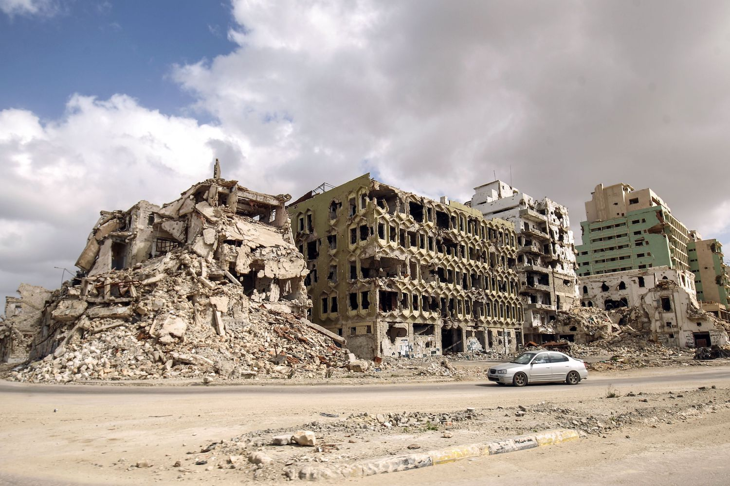 TOPSHOT - A picture taken on February 15, 2018 shows a view of destroyed buildings along the seaside promenade of Libya's eastern city of Benghazi near the Benghazi courthouse where demonstrations first broke in February 2011 protesting against the rule of late leader and strongman Moamer Kadhafi. / AFP PHOTO / Abdullah DOMA        (Photo credit should read ABDULLAH DOMA/AFP/Getty Images)