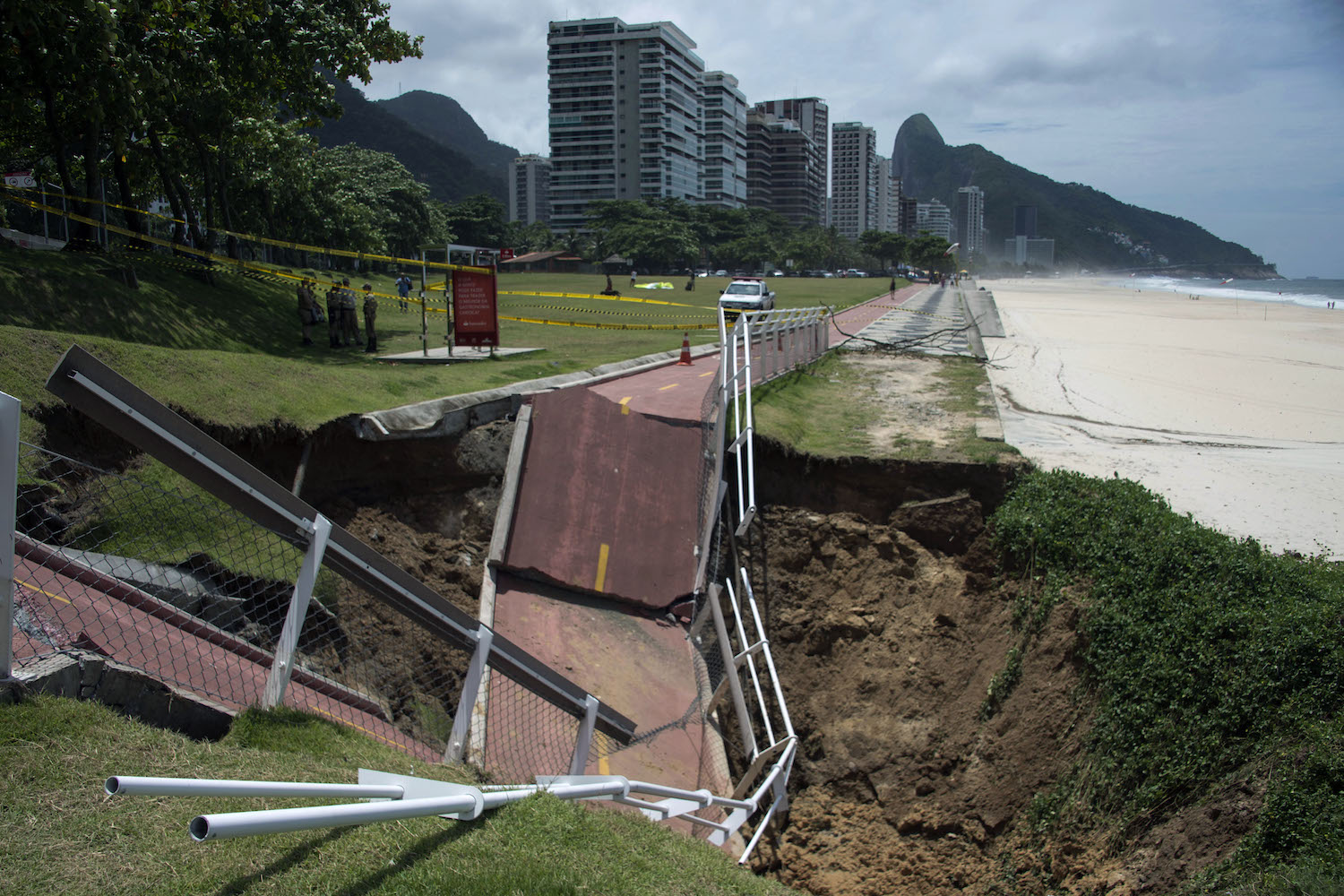 TOPSHOT - View of a bicycle lane which collapsed after being hit by a violent storm in Sao Conrado beach, Rio de Janeiro, Brazil, on February 15, 2018.  Many neighbourhoods in Rio de Janeiro ended up with blocked roads, fallen trees and floodings, after being affected by heavy rains and wind during a storm. / AFP PHOTO / MAURO PIMENTEL        (Photo credit should read MAURO PIMENTEL/AFP/Getty Images)