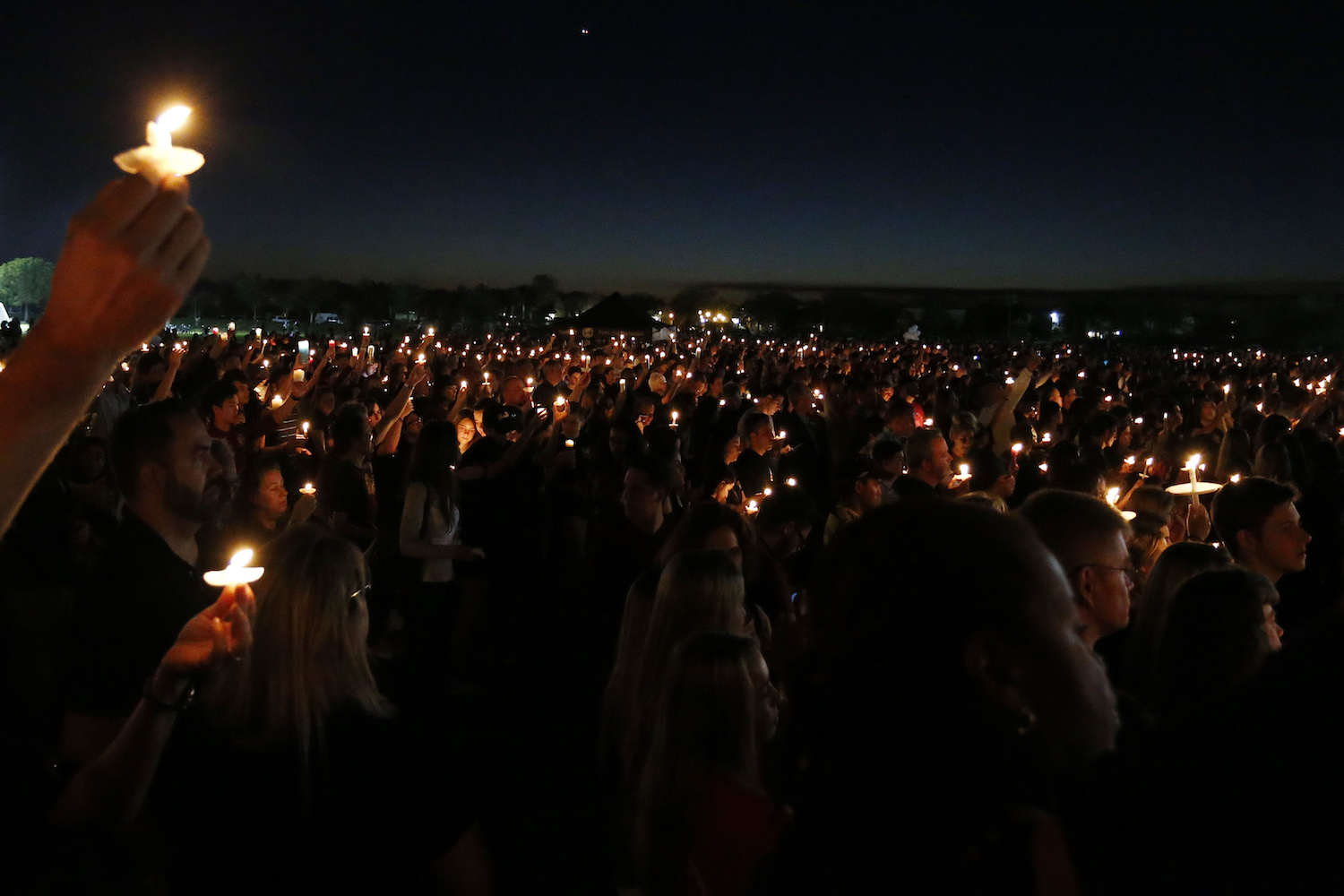 TOPSHOT - Thousands of mourners hold candles during a candlelight vigil for the victims of Marjory Stoneman Douglas High School shooting in Parkland, Florida on February 15, 2018. A former student, Nikolas Cruz, opened fire at the Florida high school leaving 17 people dead and 15 injured. / AFP PHOTO / RHONA WISE        (Photo credit should read RHONA WISE/AFP/Getty Images)