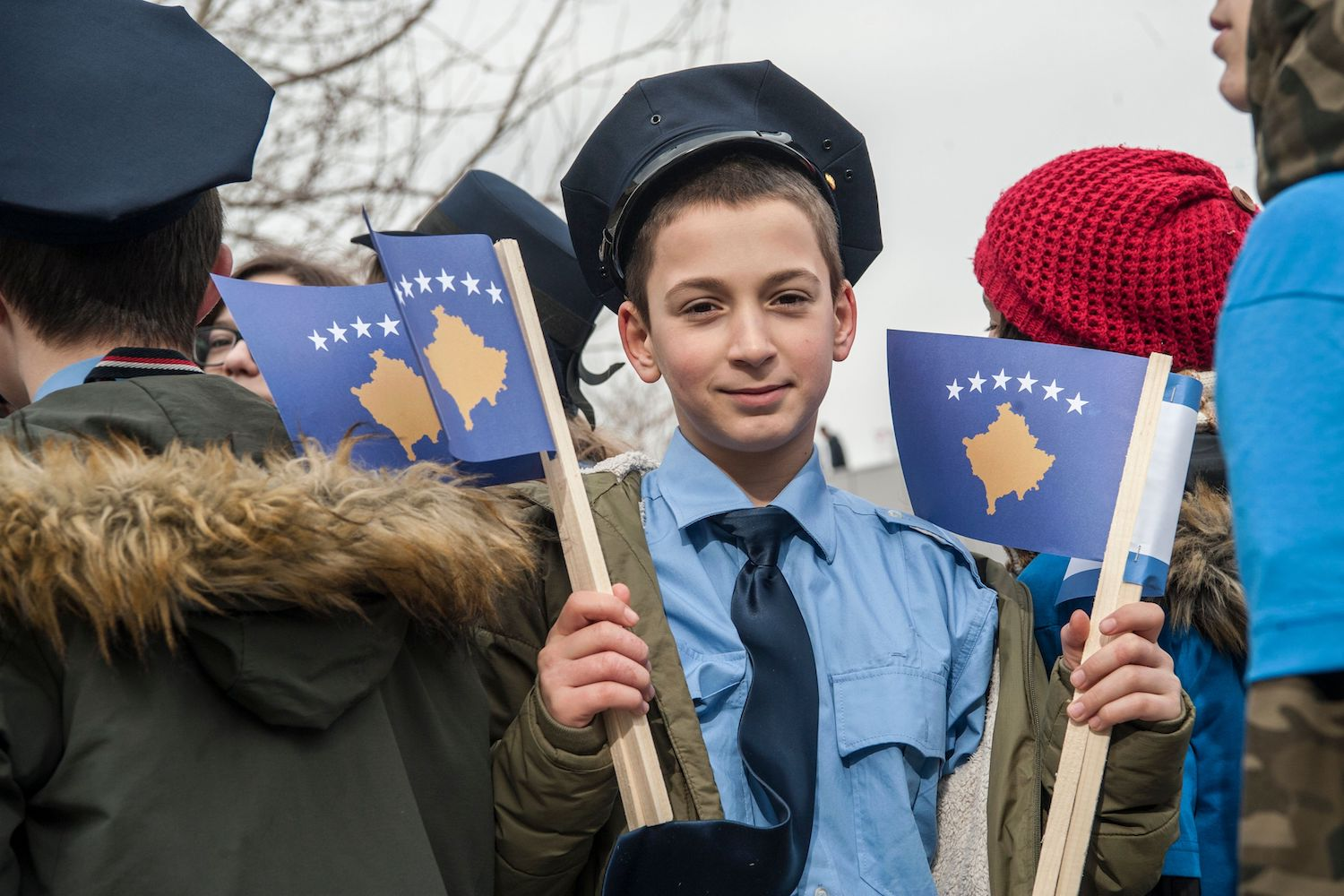 TOPSHOT - A young Kosovar boy dressed as police officer holds Kosovo flags in Pristina on February 16, 2018 on the eve of the celebrations of the 10th anniversary of Kosovo independence.  Kosovo marks the 10th anniversary of its independence from Serbia on February 17. / AFP PHOTO / Armend NIMANI        (Photo credit should read ARMEND NIMANI/AFP/Getty Images)
