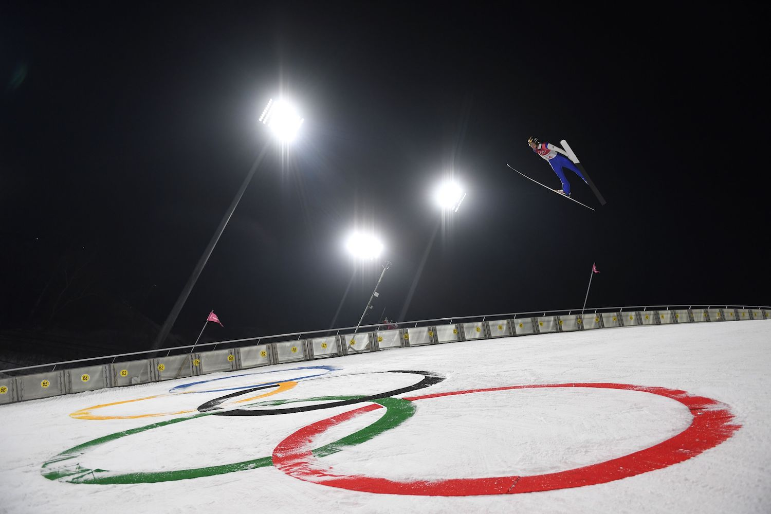 TOPSHOT - Germany's Karl Geiger competes in the men's large hill individual ski jumping trial event during the Pyeongchang 2018 Winter Olympic Games on February 16, 2018, in Pyeongchang. / AFP PHOTO / Christof STACHE        (Photo credit should read CHRISTOF STACHE/AFP/Getty Images)