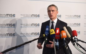 NATO Secretary-General Jens Stoltenberg answers journalists' questions as he arrives to attend the 54th Munich Security Conference on Feb. 16. (Andreas Gebert/AFP/Getty Images)