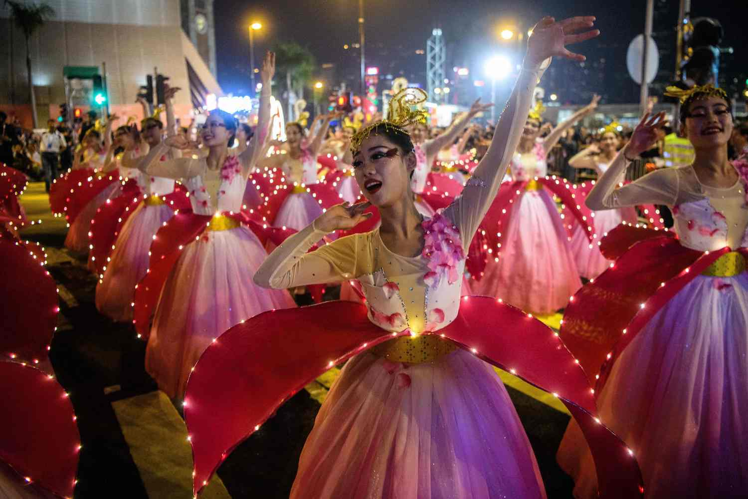 TOPSHOT - Performers take part in a street parade to mark the Lunar New Year celebrations for the Year of the Dog in Hong Kong on February 16, 2018.  / AFP PHOTO / ANTHONY WALLACE        (Photo credit should read ANTHONY WALLACE/AFP/Getty Images)