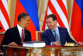 Former U.S. President Barack Obama and his counterpart Dmitry Medvedev as they sign the new Strategic Arms Reduction Treaty in Prague on April 8, 2010. (Jewel Samad/AFP/Getty Images)