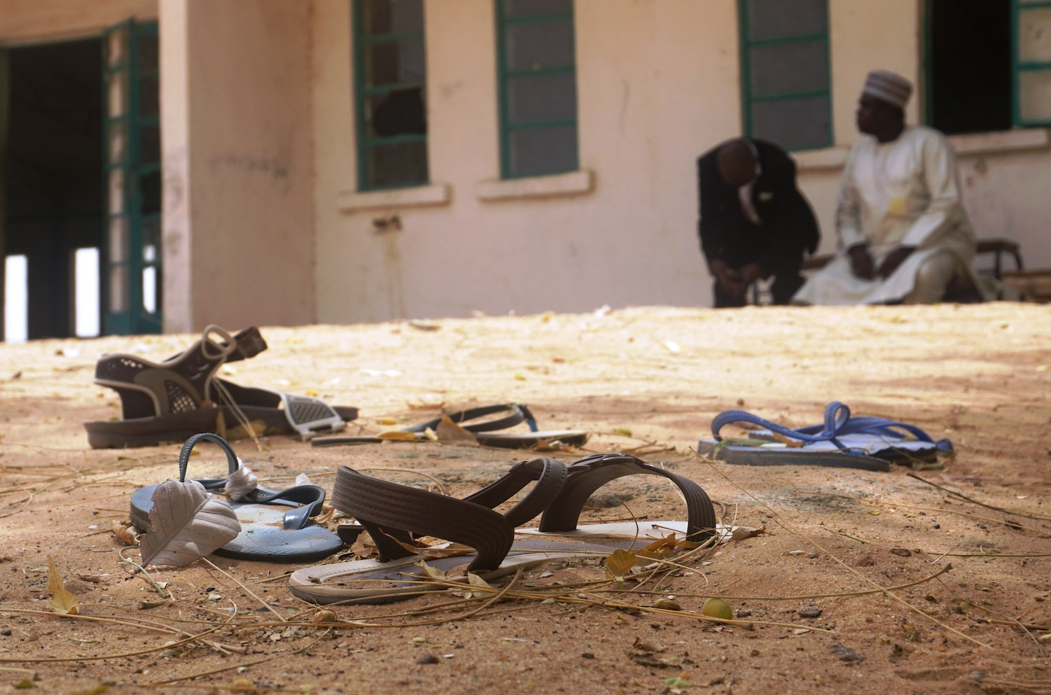 Sandals are strewn in the yard of the Government Girls Science and Technical College staff quarters in Dapchi, Nigeria, on Feb. 22. (Aminu Abubakar/AFP/Getty Images)