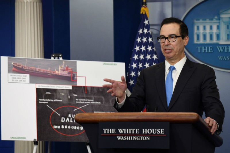 Treasury Secretary Mnuchin shows satellite photos of illicit North Korean shipping activity, Feb. 23, 2018. (Olivier Douliery/AFP/Getty Images)