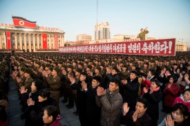 North Koreans attend a mass rally in Kim Il Sung Square in Pyongyang on Dec. 1, 2017. (Kim Won-Jin/AFP/Getty Images)