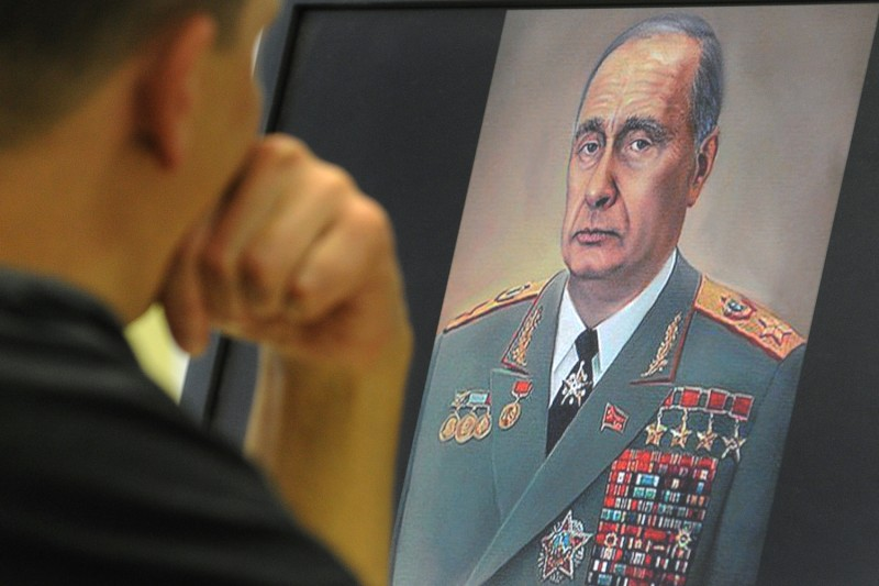 A man looks at a caricature depicting Russian Premier Vladimir Putin as Leonid Brezhnev on his computer screen in Moscow on Oct. 5, 2011.   (Alexander Nemenova/AFP/Getty Images)