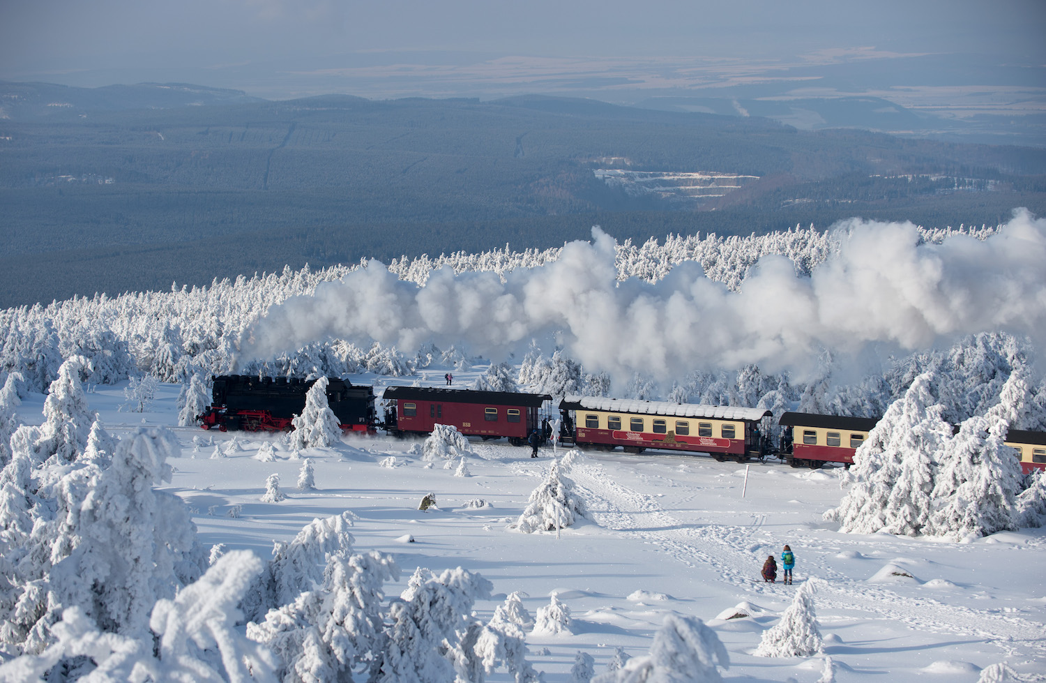 TOPSHOT - A train of the Harzer Schmalspurbahn (Harz narrow gauge train) makes its way through the snowy landscape at the Brocken mountain near Schierke in the Harz region, central Germany, on February 6, 2018. / AFP PHOTO / dpa / Klaus-Dietmar Gabbert / Germany OUT        (Photo credit should read KLAUS-DIETMAR GABBERT/AFP/Getty Images)