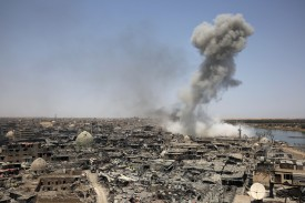 Smoke billows over Mosul, Iraq, after an airstrike by U.S.-led international coalition forces targeting the Islamic State on July 9, 2017. (Ahmad Al-Rubaye/AFP/Getty Images)