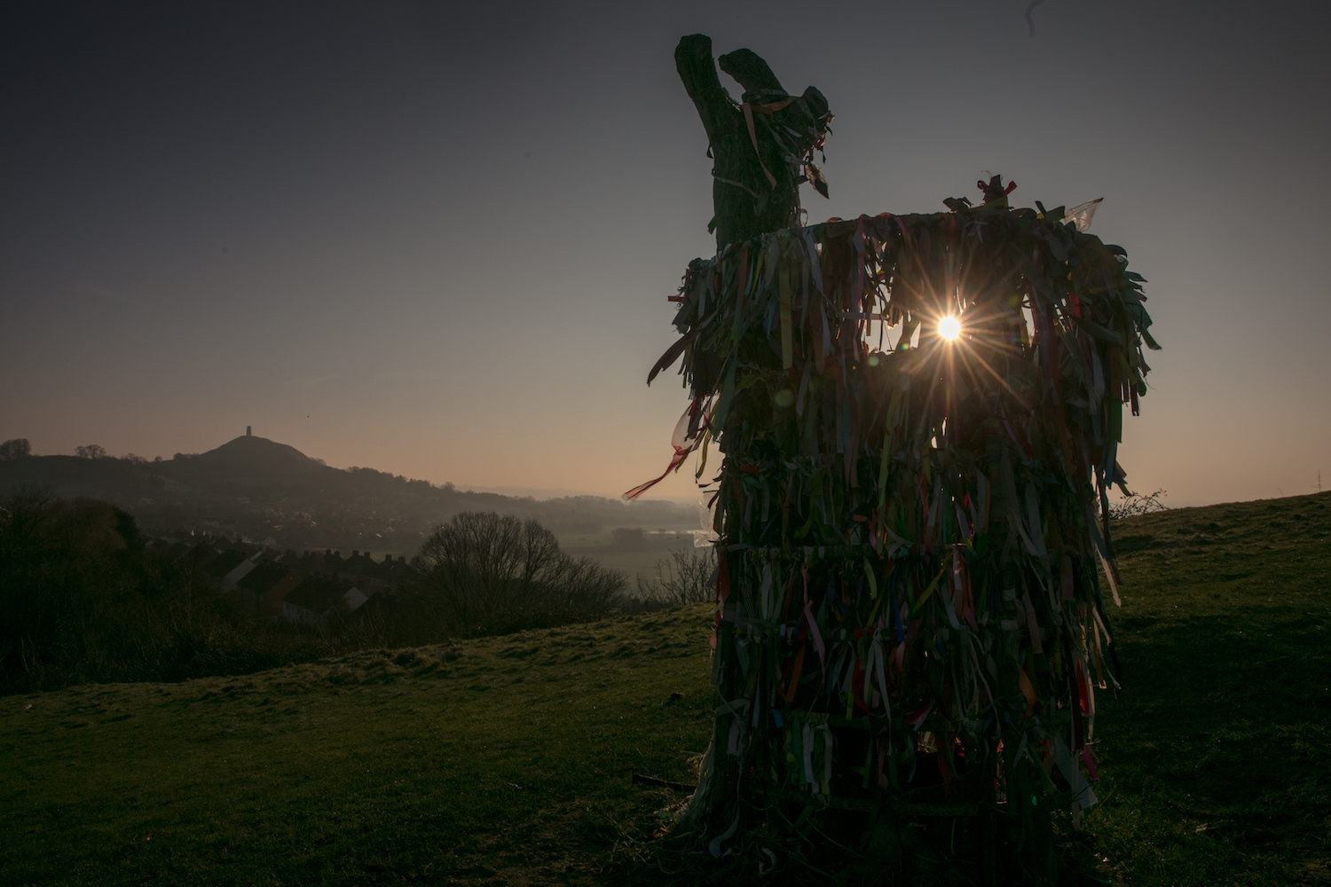 The winter sun rises behind the Holy Tree on Wearyall Hill near Glastonbury in Somerset, England on Feb. 23, 2018. Weather forecasters are warning that a Siberian Arctic blast nicknamed the 'beast from the east' will envelop the UK next week in what could be the coldest end to the British winter for five years, will causing temperatures to plunge below zero from Sunday night and bringing the risk of significant snowfall to London and the east of England.  (Photo by Matt Cardy/Getty Images)