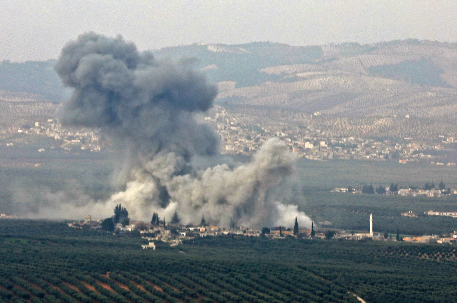 Smoke billows in the Deir Ballut region in northern Syria, where Turkish forces and allied Syrian rebel groups are conducting an offensive on February 9, 2018 as seen from the northern border Syrian town of Atmah.  / AFP PHOTO / OMAR HAJ KADOUR        (Photo credit should read OMAR HAJ KADOUR/AFP/Getty Images)