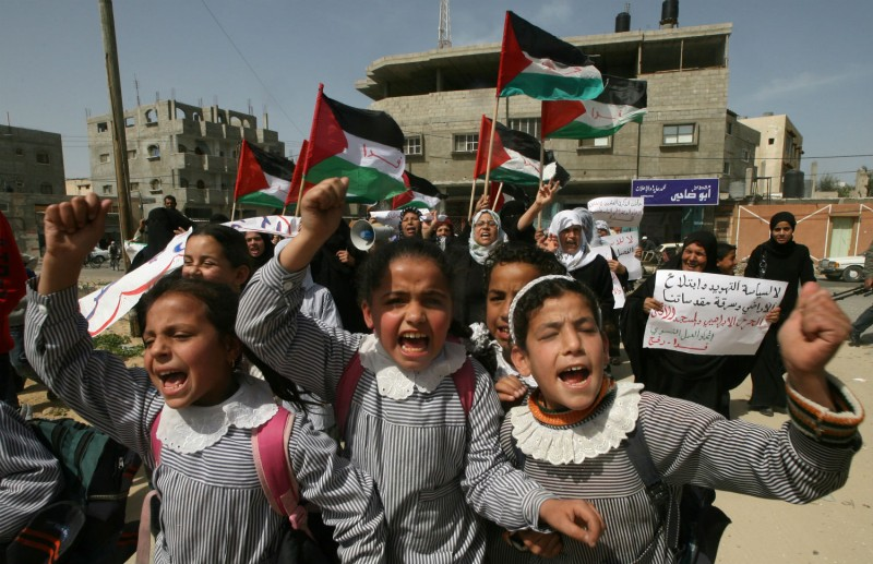 Palestinian schoolgirls and women attend a protest in the southern Gaza Strip refugee camp of Rafah on March 8, 2010. (Said Khatib/AFP/Getty Images)