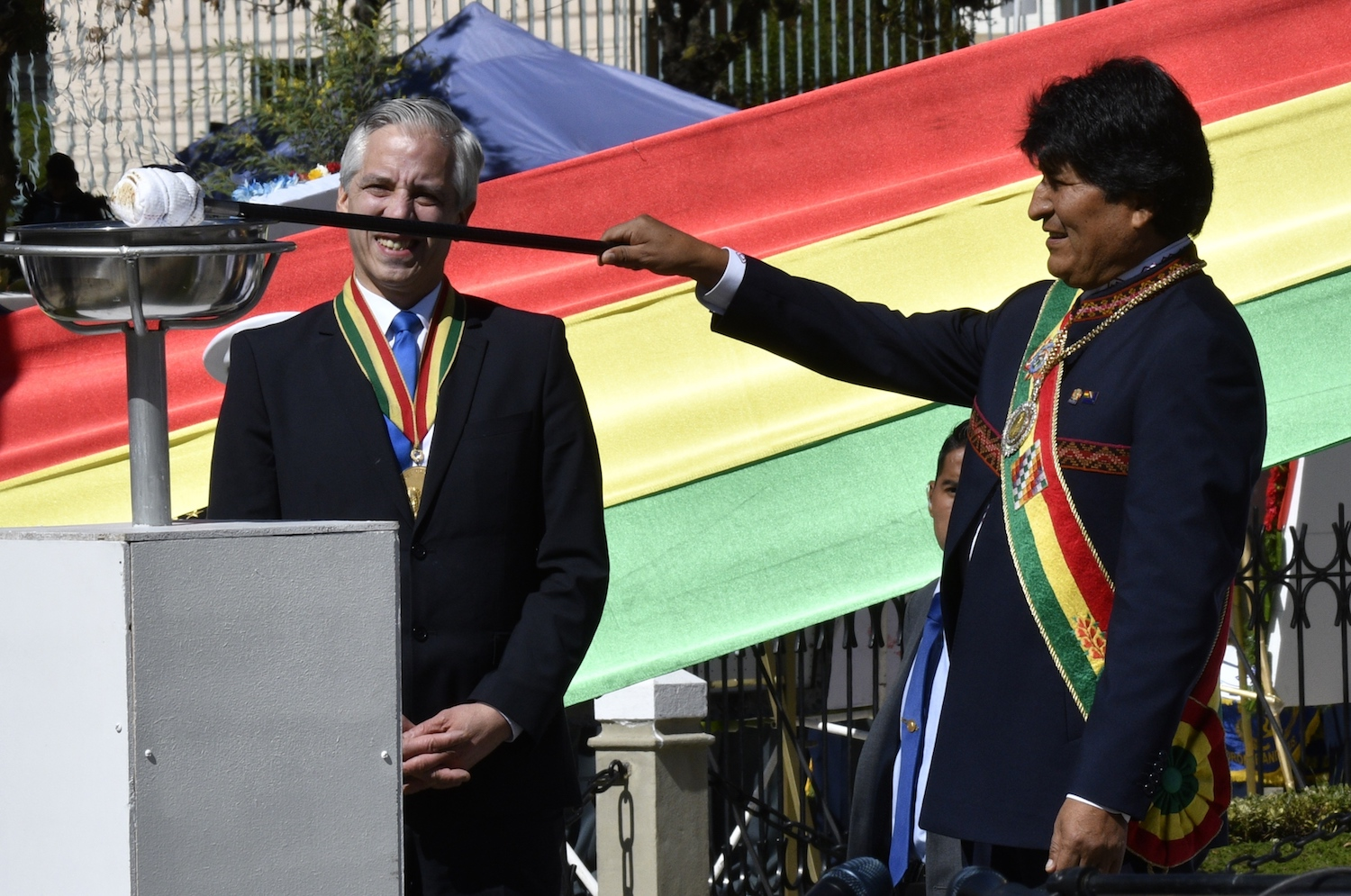 Bolivian President Evo Morales (R) lights a votive flame as Vice-President Alvaro Garcia Linera looks on at the Eduardo Avaroa Monument in La Paz on March 23, 2018 during the commemoration of the 139th anniversary of the Battle of Calama, during a four-year war with Chile, in which Bolivia lost its access to the sea to Chile. Hearings at the UN's top court have taken place between March 19 and 23, while three more days of talks are planned next week. Following some 130 years of fruitless negotiations with Santiago, landlocked Bolivia lodged a complaint with the International Court of Justice (ICJ) based in The Hague in April 2013 urging UN judges to rule that Chile has a legal obligation to enter into negotiations to end the row. / AFP PHOTO / Aizar RALDES        (Photo credit should read AIZAR RALDES/AFP/Getty Images)