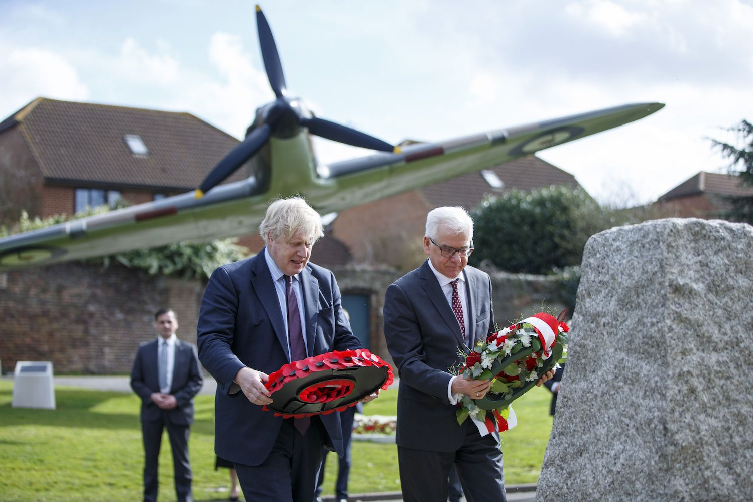 Britain's Foreign Secretary Boris Johnson (l) and his Polish counterpart Jacek Czaputowicz lay wreaths during a visit to a Battle of Britain bunker in Uxbridge, west London on March 16, 2018.   / AFP PHOTO / POOL / Tolga Akmen        (Photo credit should read TOLGA AKMEN/AFP/Getty Images)